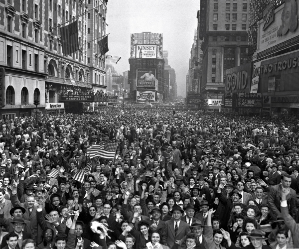 New York City, May 7, 1945--The end came rapidly. On April 30, with Russian troops on his doorstep, Hitler killed himself in his bunker in Berlin. On May 4, German forces in Holland, Denmark and northwest Germany surrendered to British Field Marshal Montgomery. On May 7, Germany signed an unconditional surrender with the Allies in Reims, France. Here, looking north from 44th Street, New YorkÕs Times Square is packed with crowds celebrating the news. (AP Photo/Tom Fitzsimmons)